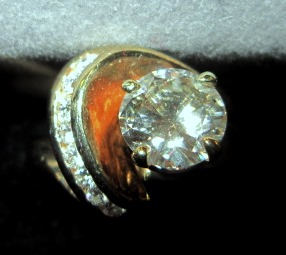 Round Brilliant Center Diamond with Side Channel Set Diamonds